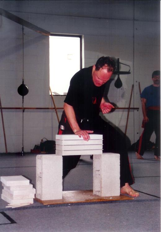 Sifu Eric Kraushaar breaking concrete at Waterloo Kung-Fu Academy
